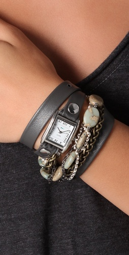 This wrap watch features an Italian leather band, studs, and a square case. Stone and bead strand and mixed-metal chains.