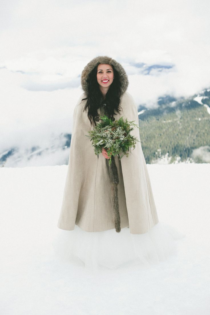 winter bride in snow photograph by Whistler Wedding Collective