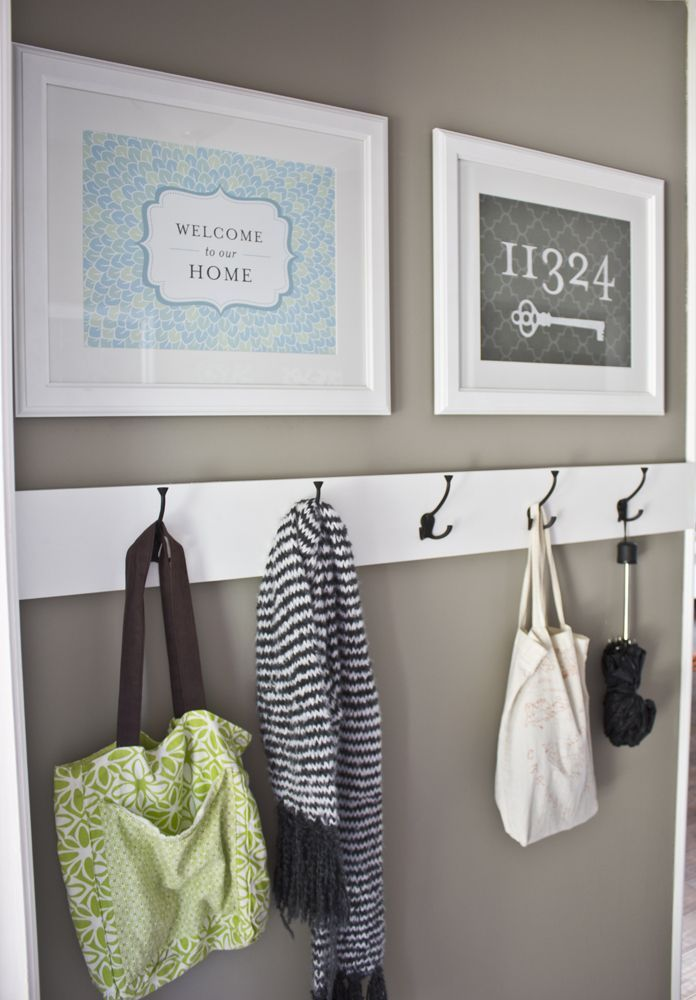 I like the use of a piece of wood to hold the hooks. A little pretty artwork might be nice too.