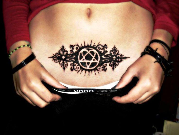 Lower stomach heartagram tattoo
