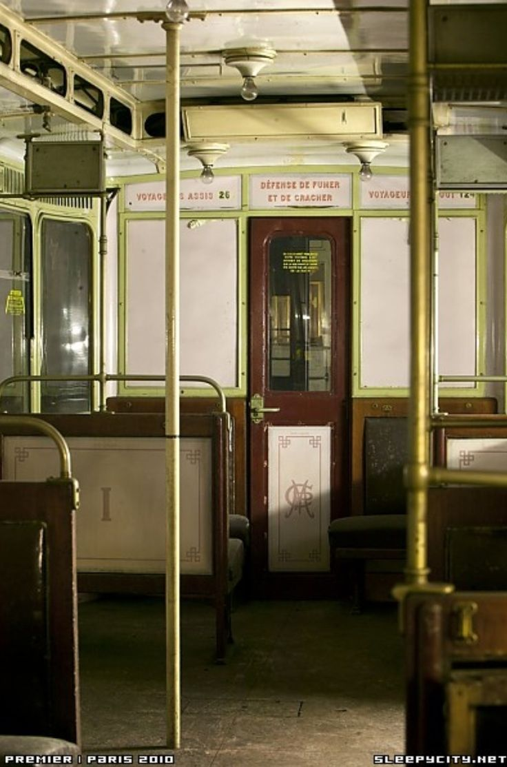A vintage Paris metro subway car sits abandoned in a garage - the ghost stations were closed when France entered World War II in September 1939, and some have been closed ever since. Some stations were constructed but never actually used, and today still have no public access from the streets.