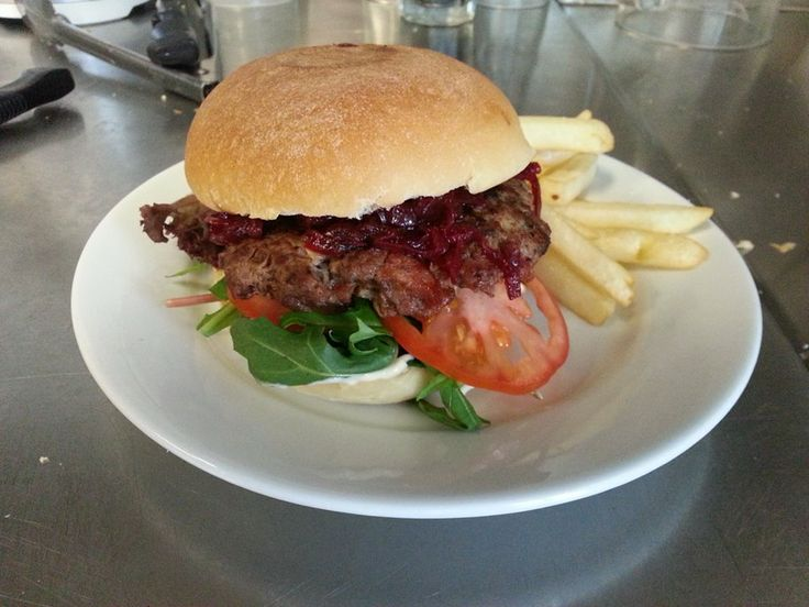 beef and chorizo burger with caramelized onion and beetroot relish and horseradish cream.