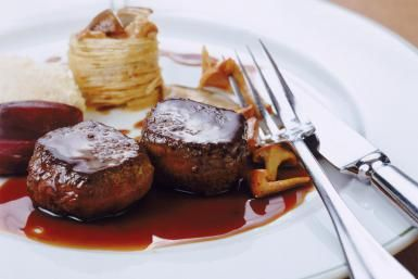 Tenderloin, savory sauce and fork on plate, close-up - John Foxx/Stockbyte/Getty Images