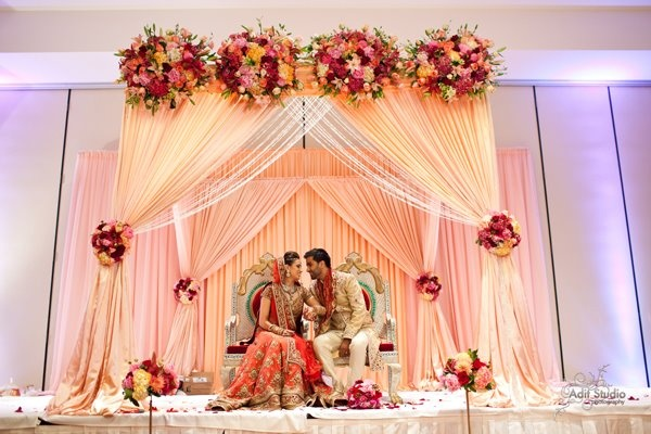 Long Shot capturing the beauty of the mandap, bride and groom colors