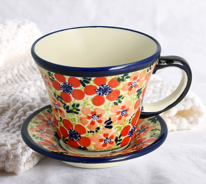 Cup with saucer. Made of natural ceramic clays, hand formed and hand decorated by Bolesławiec artist.