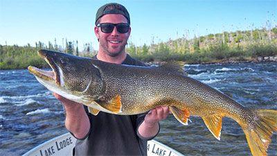 Big lake trout caught fishing choppy water.