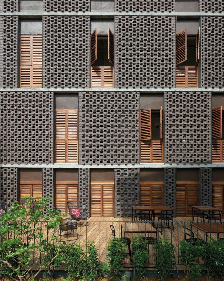 exterior, open cell dark brown brick and wood shutters | Lantern Hotel / ZLGdesign