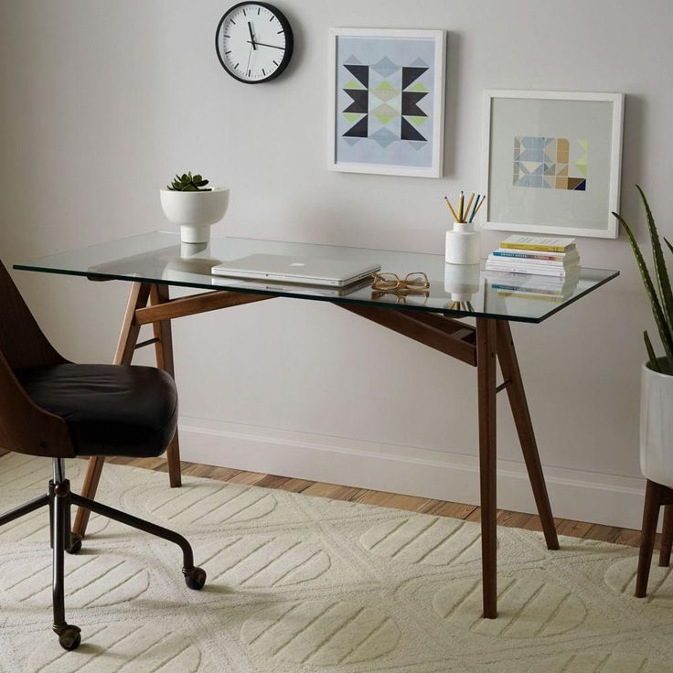 Our retro-inspired Jensen Dining Table was such a clear winner that we decided to make a desk with the same solid wood A-frame base and glass top.
