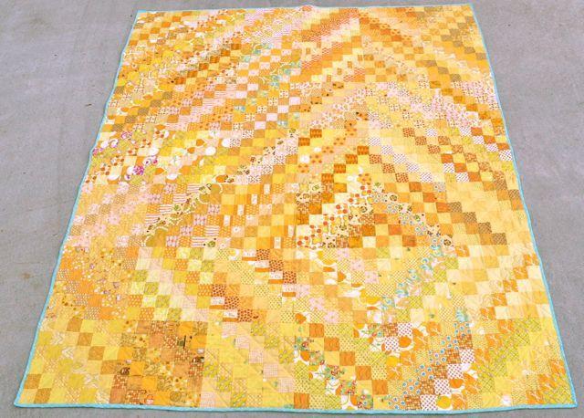 yellow scrappy trips around the world quilt   whipstitch