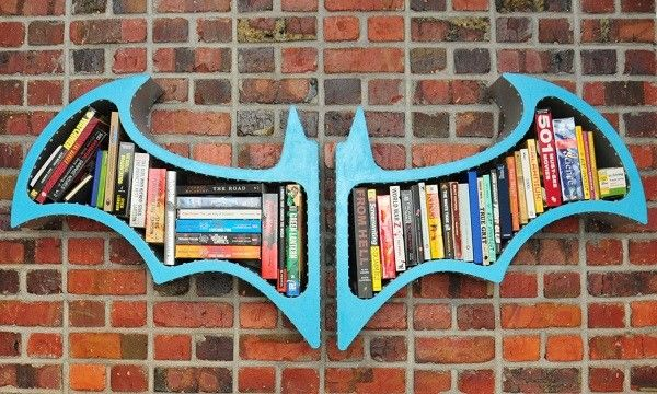 Superhero Hanging Bookshelf - Bookshelves are usually just boring wooden furniture but what if you can incorporate your son's favorite superhero into the mix? How? Here's an example. A hanging bookshelf in the shape of Batman's logo. Imagine how it will look like if your son like Thor or Capt. America. Perhaps it is time to design a Mjolnir or a shield for his bookshelf.