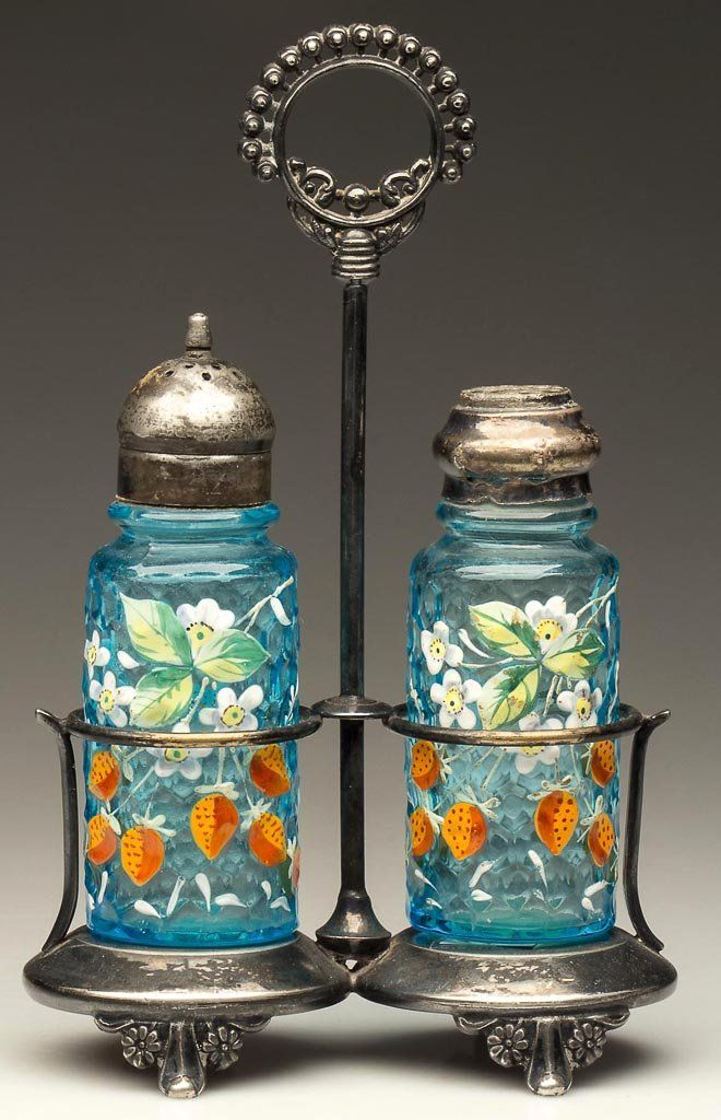 """HONEYCOMB PILLAR PAIR OF SALT AND PEPPER SHAKERS, turquoise with polychrome floral, strawberry and dragonfly decoration, each with near-matching period two-part lids. Fitted in a quadruple-plate stand marked """"TO.B.P.COMPANY"""". Possibly Mt. Washington Glass Co. Fourth quarter 19th century"""