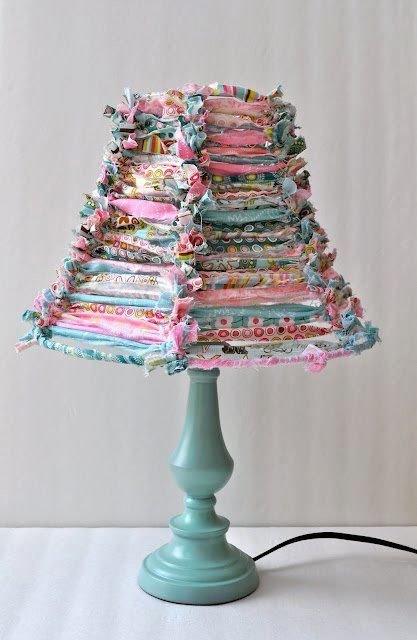 Lampshade with fabric strips tied around the wires.  (Purchase Fabric Strips here: http://www.shopbetterlifebags.com/collection/scraps-crafts)