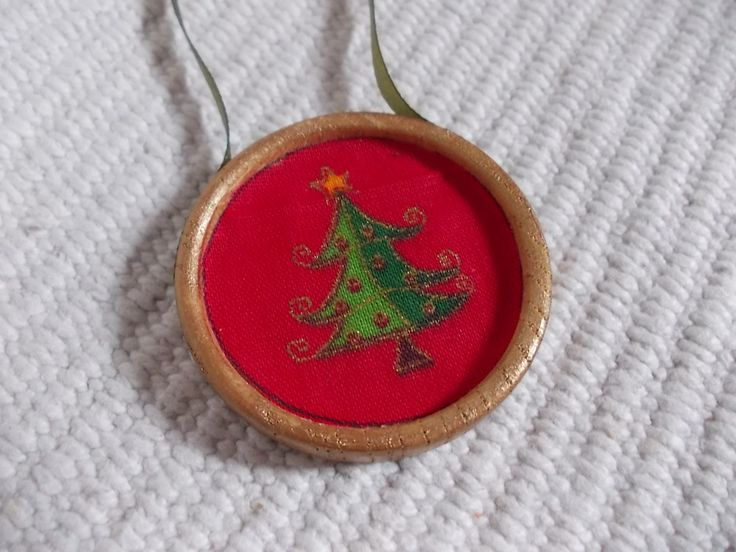 Antiqued wooden and textile decoration with tree xmas tree pattern