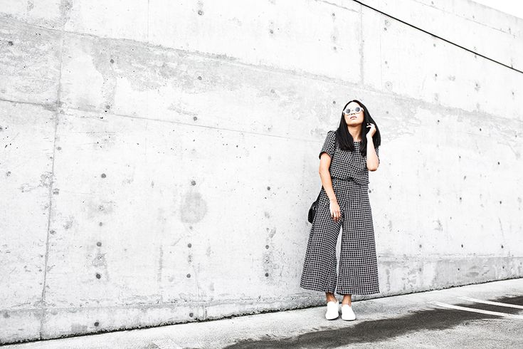 Shop this look for $98:  http://lookastic.com/women/looks/black-and-white-jumpsuit-white-slip-on-sneakers-black-crossbody-bag-black-and-white-sunglasses/6866  — Black and White Check Jumpsuit  — White Slip-on Sneakers  — Black Leather Crossbody Bag  — Black and White Sunglasses