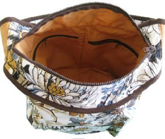 Make this fashionable carry all bag that has box pockets on the outside and zippered pockets on the inside. Get that professional looking finish so you can zip it up and throw it over your shoulder.