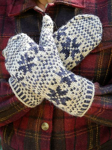 Stranded colorwork mittens are worked in the round from the bottom up with an after-thought thumb.
