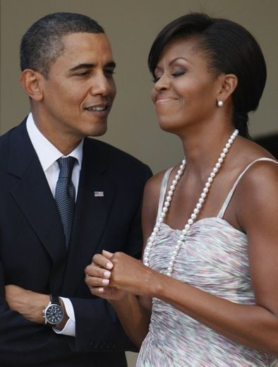 Our President can't keep his eyes off his lovely wife. Love this picture!
