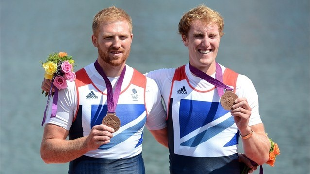 William Satch and George Nash of Great Britain celebrate with their bronze medals