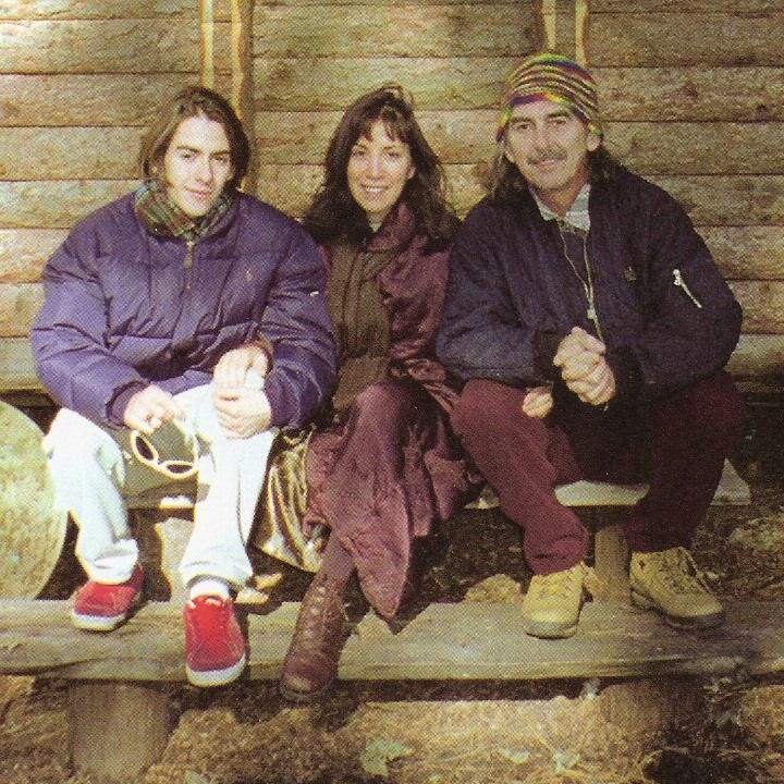 Christmas photo of the Harrison family. From left to right Dhani Harrison (son), Olivia Harrison (2nd wife) and George Harrison.