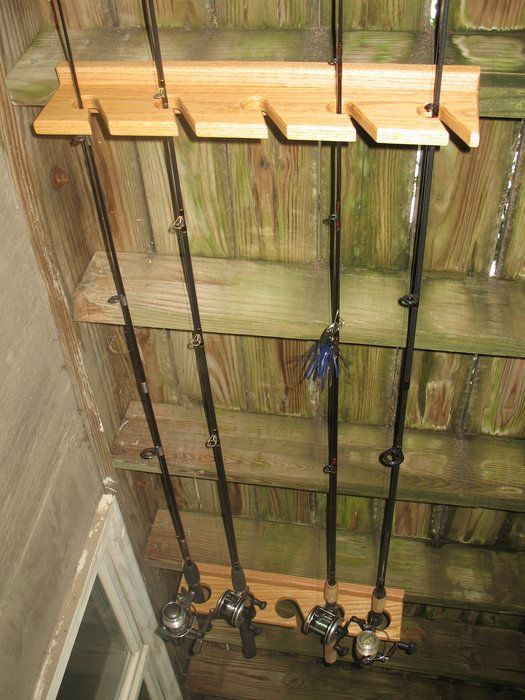 Best 25 fishing rod rack ideas on pinterest fishing for Homemade fishing rod storage ideas