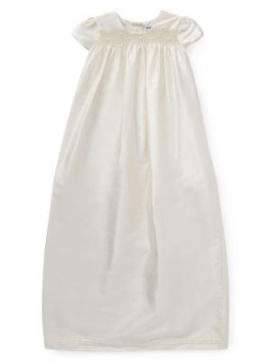 This pure silk unisex smock dress is the ideal choice for a traditional christening outfit.  It comes in a protective sleeve with a padded satin hanger.