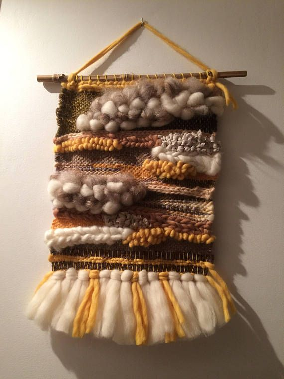 Inspired by Icelandic landscapes, this original wall weaving was made in joy and with great care from reported raw wool from Iceland! It goes with any home, why not yours? It can also be a very original gift! Weaving dimensions: 30cm width, length 41 cm. With stand and hook size: 48