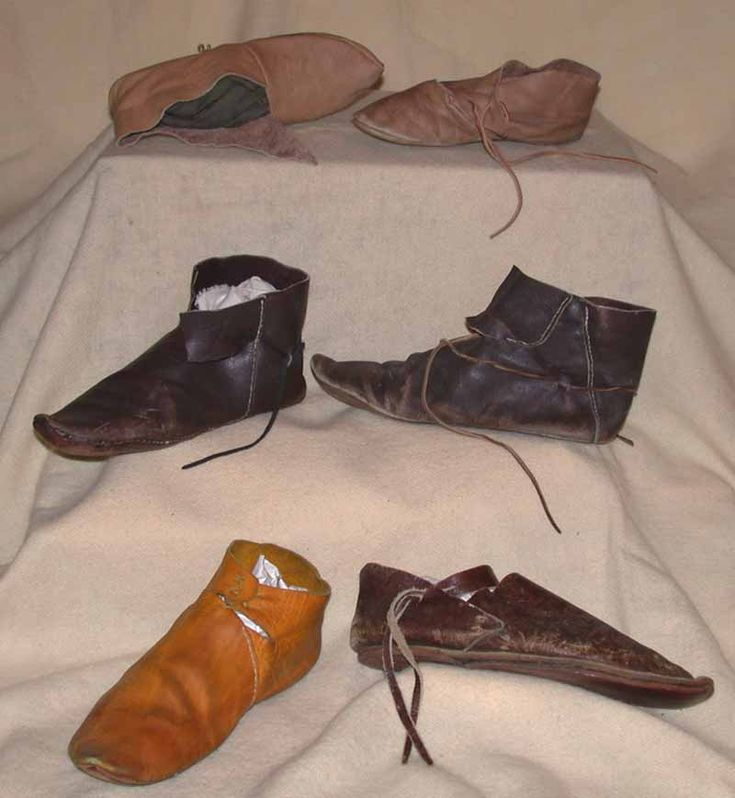 """This picture is a representation of medieval shoes. These shoes were reffered to as """"turn shoes"""", sewn together inside out and then turned right side out, to keep the stitching protected from wear."""