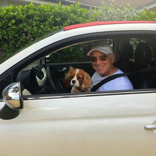 Jimmy Buffett going to the Beach with his dog.