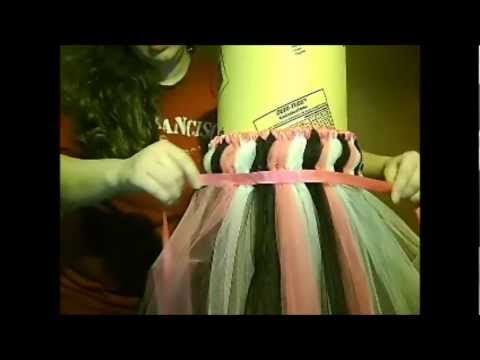 """DIY No Sew Tutu Flower Girl Dress Tutorial! All you need is about 5 spools of 6"""" wide 25 yard long tulle in the colors of your wedding. You can use a roll of paper towels instead of the concrete tube. And check out Papermart.com for cheap tulle in lots of colors. You probably can make this dress for less than $20!"""