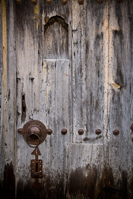 Old wood with old metal hardware.