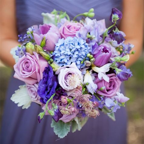 Purple Hued Bridesmaids Bouquet - might be a little too pastel for our color palette but we like the different types of flowers