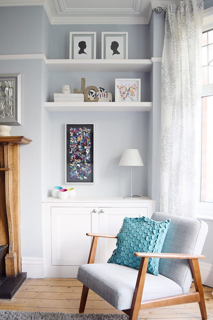 Modern Edwardian Living Room painted in Dulux Steel Symphony with built in alcove cupboards and a mid century style armchair from Ikea