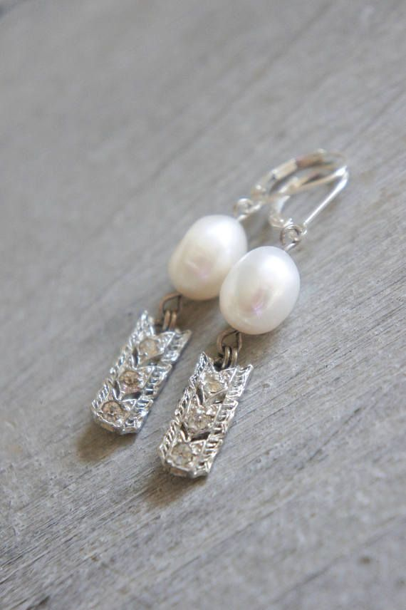 Sweet little vintage rhinestone dangle earrings. The vintage dangles are links for an antique bracelet circa 1930s. They are set with tiny rhinestones and have a chevron pattern on them. I have hung them from beautiful white freshwater pearls. The earrings are finished off with