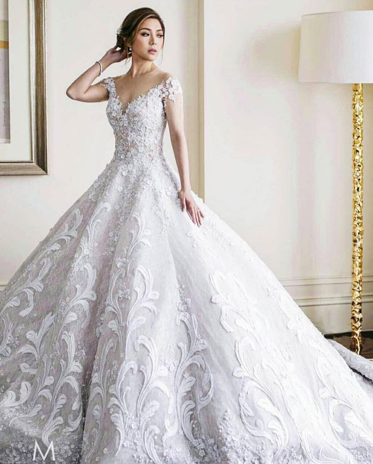 White sweetheart off the shoulder wedding dress // Filipino designer Mak Tumang studied interior design before delving into fashion in the Philippines. His love of opulent costumes and architecture influences his designs and this can be seen in his gowns which are rich in elaborate detail.