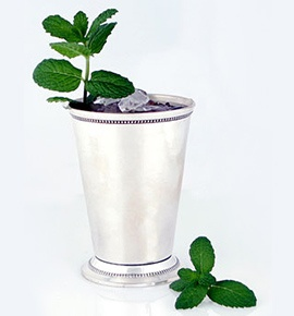 MINT JULEP — To highball glass or Julep cup, add 1 scant oz minted simple syrup*, then 1 C crushed ice, 2 oz Woodford Reserve bourbon, and splash of water. Add more crushed ice to almost fill glass. Stir well and garnish with mint sprig. *FOR THE SYRUP: In heavy med saucepan over med heat, stir together water & sugar til sugar dissolves. Increase heat slightly & simmer 5 mins stirring occasionally. Take pan off heat, add 1 bunch mint and steep 15 mins. Strain, refrigerate til cold.