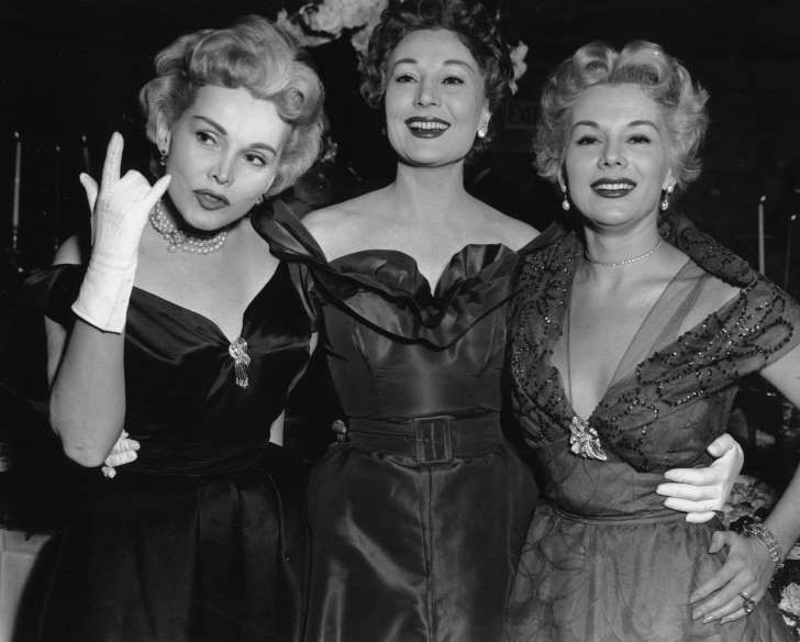 Ms. Zsa Zsa Gabor, left, with her sisters Madga and Eva in 1955.