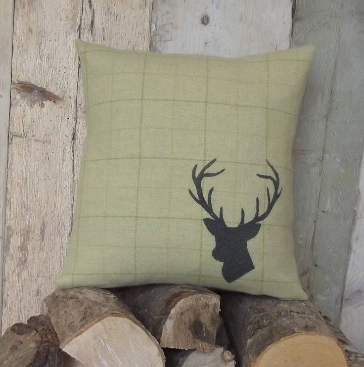 Hand Printed Irish Tweed Stag's Head Cushion from notonthehighstreet.com
