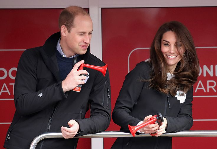 William showed off his playful nature by blowing a red horn at his wife Kate