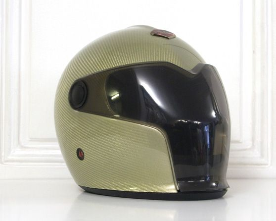 French helmet designer and manufacturer Ruby is showing a different helmet concept, especially created to match the striking silhouette of another French project: the Peugeot electric race car dubbed the EX1.