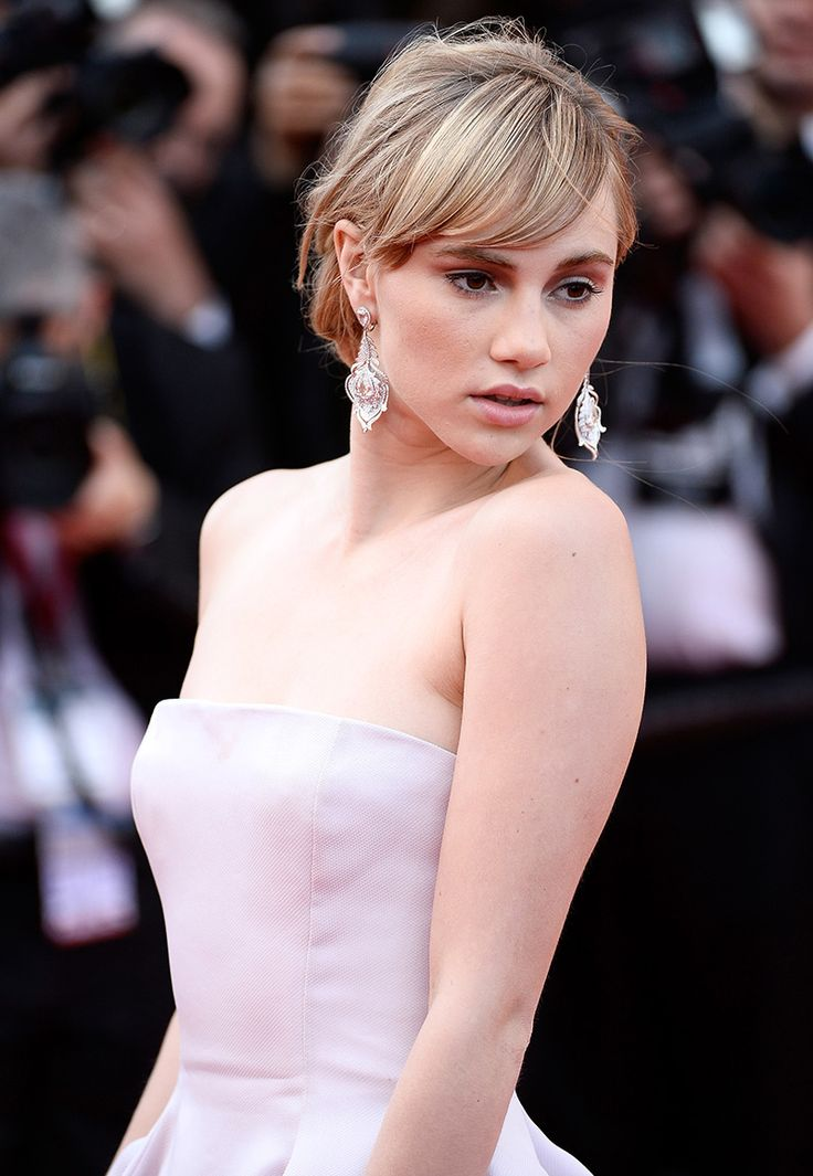 Statement Earrings are Trending at Cannes 2014. Suki Waterhouse in diamond statement feather #earrings at the Red Carpet during Cannes Film Festival 2014 #Cannes2014 #trendy #jewelry