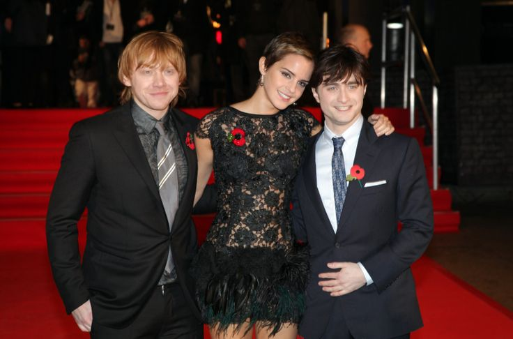 "Harry Grint, Emmy Watson and Daniel Ratcliff at a party for ""Harry Potter and the Deathly Hallows, Part 1""."