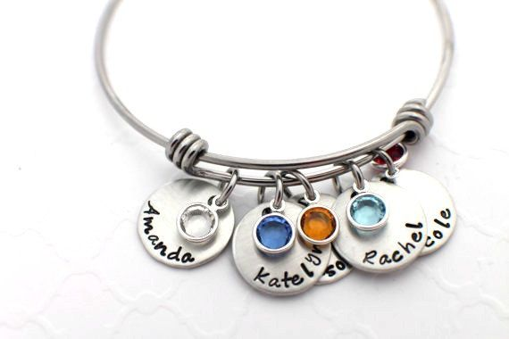 Hand Stamped Personalized Mom Bracelet - Adjustable Bracelet - Mother's Bracelet with Birthstones - Birthstone Bracelet - Mother's Day Gift    This is a Stainless Steel wire bracelet!  Adjustable!  With pewter round charms with your choice of name and birthstone dangle.    Please remember that each piece is hand stamped specifically for you by me. Letters may not always be perfectly aligned and some letters may strike deeper than others. This makes your jewelry uniquely yours and gives it…