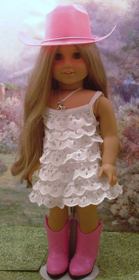 Very sweet little white eyelet dress, necklace, pink hat, and boots for your American girl doll. Dress is over the head (no velcro). Necklace