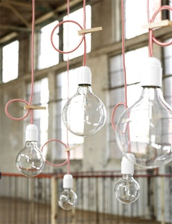 clear bulbs, pink cords, wooden pegs