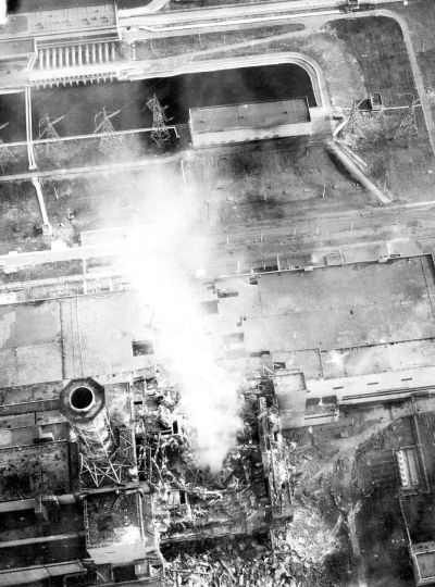 Chernobyl aerial view into the core, smoke from the graphite fire and core melt down. The photo was taken from a helicopter on May 3, 1986, of the destroyed Unit 4.