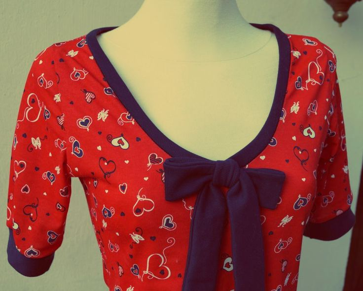 Red and navy hearts blouse with navy trim. Will be available soon.