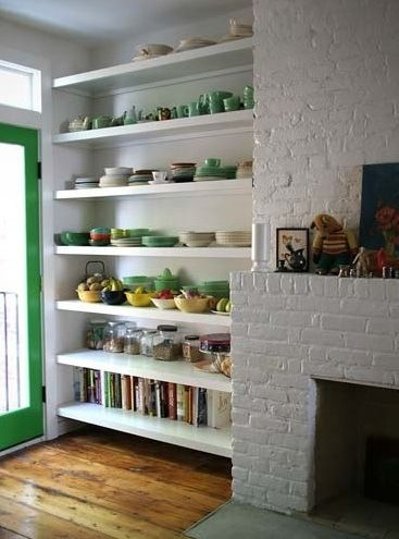 Open shelf kitchen - Also totally love the fireplace! How nice would it be to have a little sitting area in the kitchen??