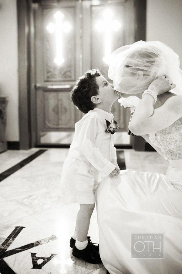 bride and ring bearer kiss wedding photo ideas