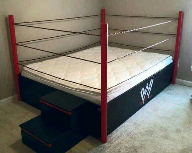 WWE WRESTLING RING BED. CUSTOM HOME-MADE Frame with Ring Steps and WWE LOGO on the side!  Looks to be a Full-Size Mattress.  Not produced by the WWE and likely one-of-a-kind.  Fun bed for kids!