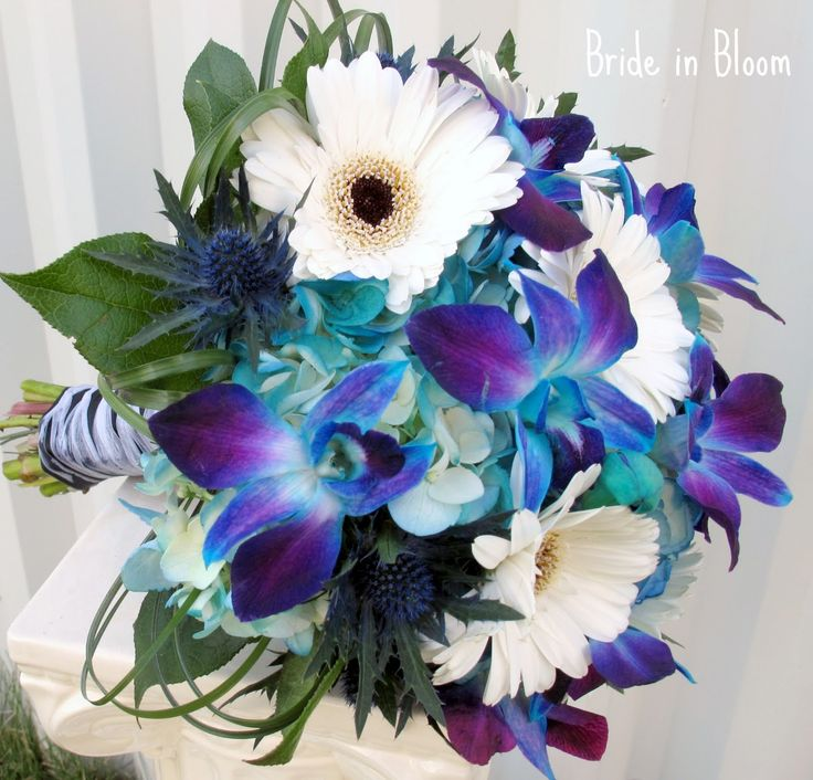 blue wedding bouquets | bridal bouquet of blue orchids white gerbera dasies bridal bouquet